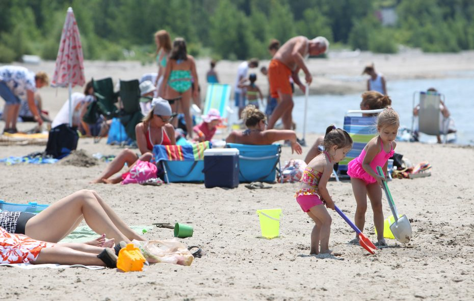 Woodlawn Beach is a popular place to be on a hot day in July. (Photo by Sharon Cantillon/Buffalo News)