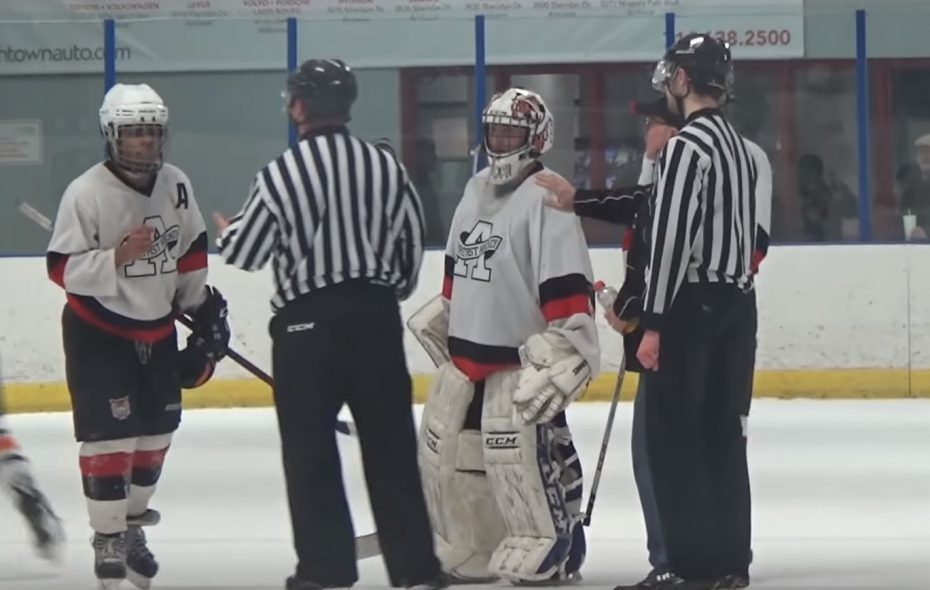A still image from a YouTube video of an 18-and-under hockey game from Jan. 20 at the Northtown Center between the Cheektowaga Warriors and Amherst Youth Hockey. Roshaun Brown-Hall, left, and Amherst teammates speak with referees at the end of the game.