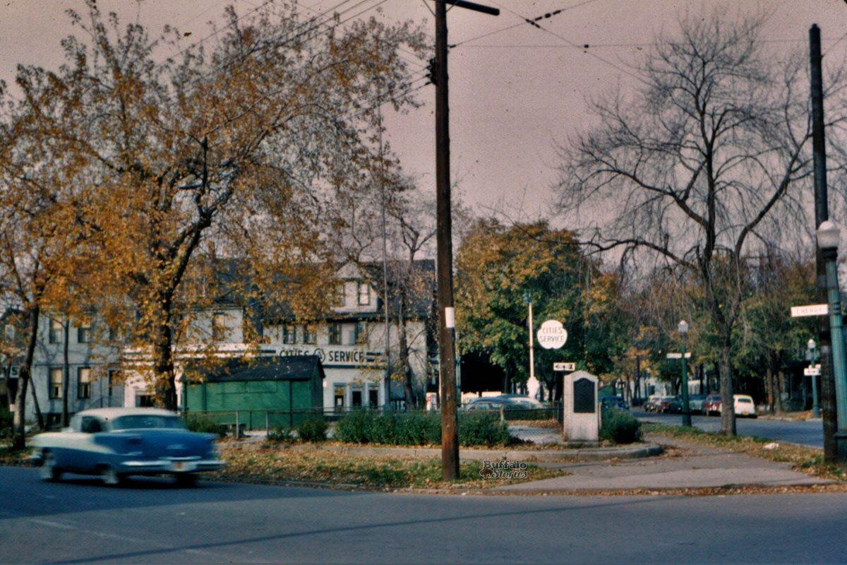 A portable green voting shed, at the corner of Cherry and Goodell, in the mid-1950s, before the East Side neighborhood was destroyed with the building of the Kensington Expressway.