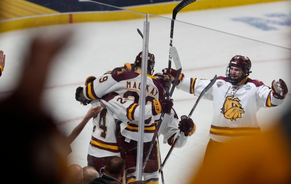 Minnesota Duluth Bulldogs defenseman Mikey Anderson (24) celebrates scoring his goal in the second period of Saturday night's NCAA Frozen Four Championship game at the KeyBank Center. (Mark Mulville/Buffalo News)