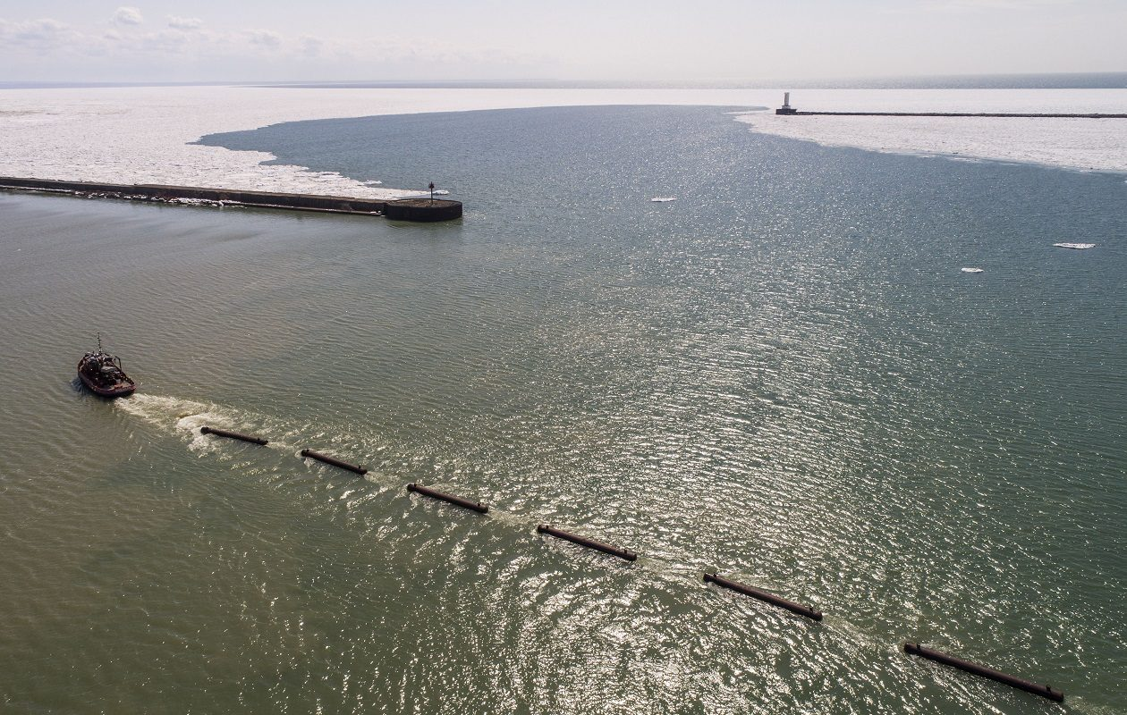 The New York Power Authority's ice-breaking tug boat 'Breaker' last April pulled a section of the ice boom into the Outer Harbor for staging after crews removed it from Lake Erie. (Derek Gee/News file photo)