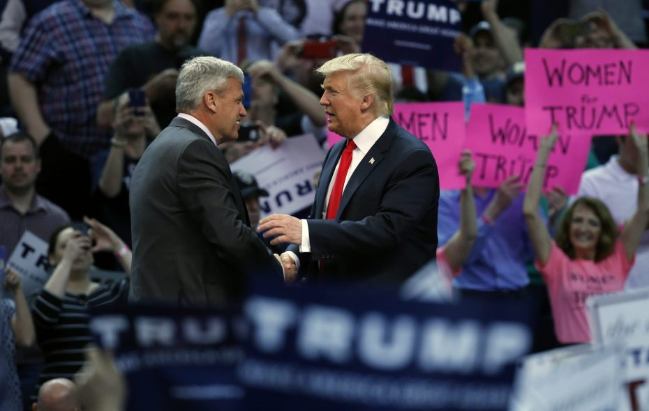 Former Bills coach Rex Ryan shakes hands with Donald Trump after introducing him at a campaign rally in KeyBank Center in April 2016. Trump's bid to buy the Bills is now at the center of three separate Democratic investigations. (Harry Scull Jr./News file photo)