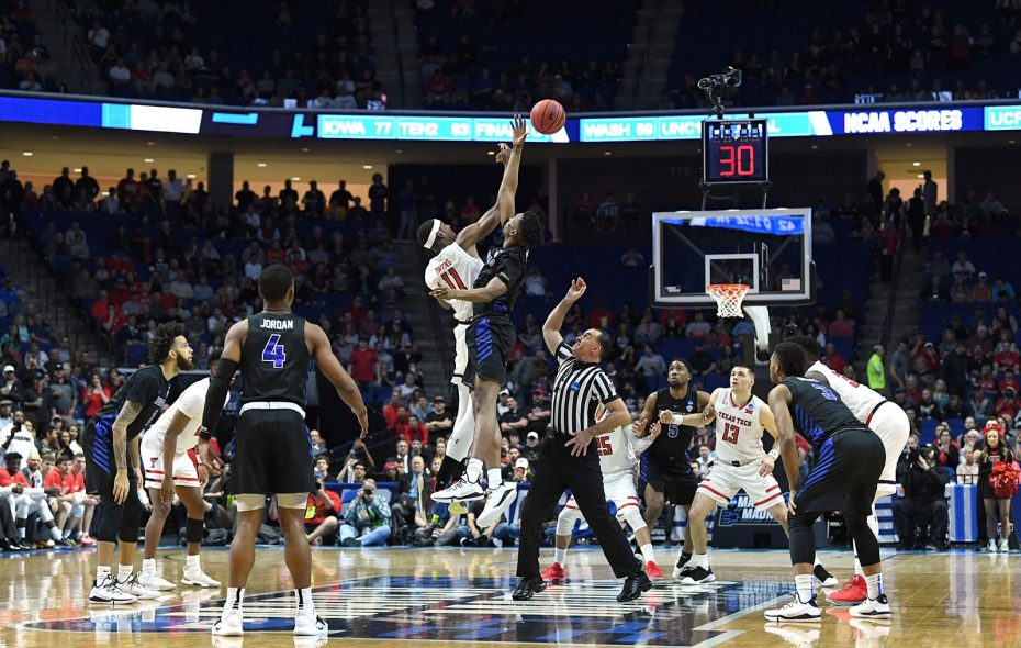 Texas Tech's Tariq Owens and Buffalo's Montell McRae tip off the start of an NCAA Tournament game March 24 in Tulsa, Okla. (Getty Images)