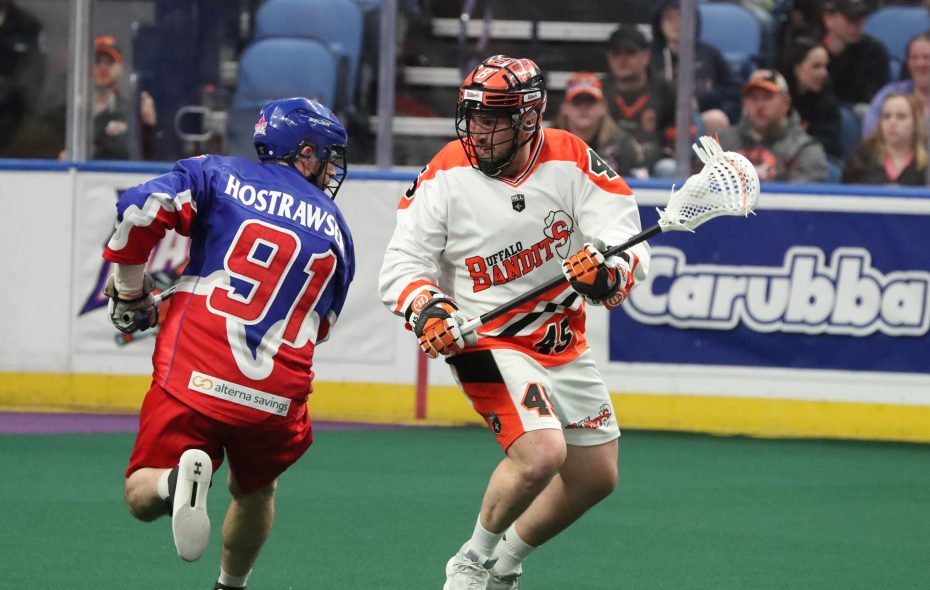 Bandits' Corey Small passes the ball around Toronto's Billy Hostrawer in the first half (James P. McCoy/Buffalo News)