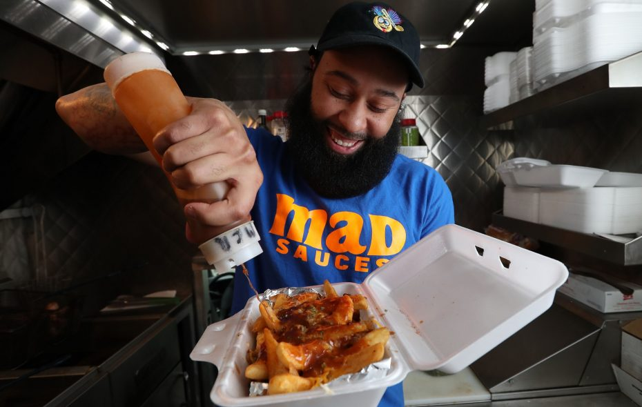 Jamel Humphrey runs the new food truck Mad Sauces, which features more than 20 different toppings for his chicken, burgers and fries. (Sharon Cantillon/Buffalo News)