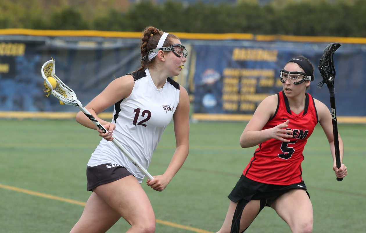 Sacred Heart's Kayleigh Colleary beats Buffalo Seminary's Alessandra Celotto for the ball in the second half of the Monsignor Martin girls lacrosse semifinals at Canisius College on Saturday, May 11, 2019.  (James P. McCoy/Buffalo News)