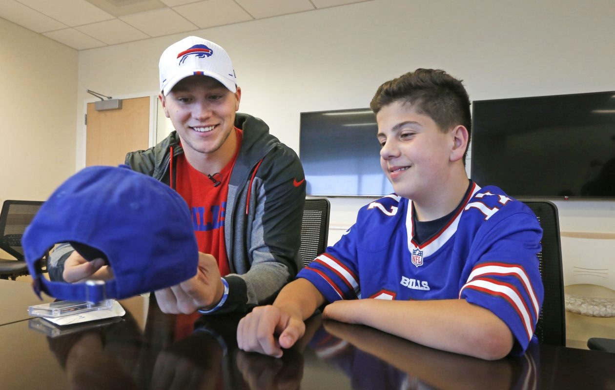 Bills quarterback Josh Allen (left) and Oishei Children's Hospital patient Beau Barnard, 11, from Marilla, a sixth grader at Iroquois Middle School, headed up a team to design a limited edition hat that New Era will produce. (Robert Kirkham/Buffalo News)