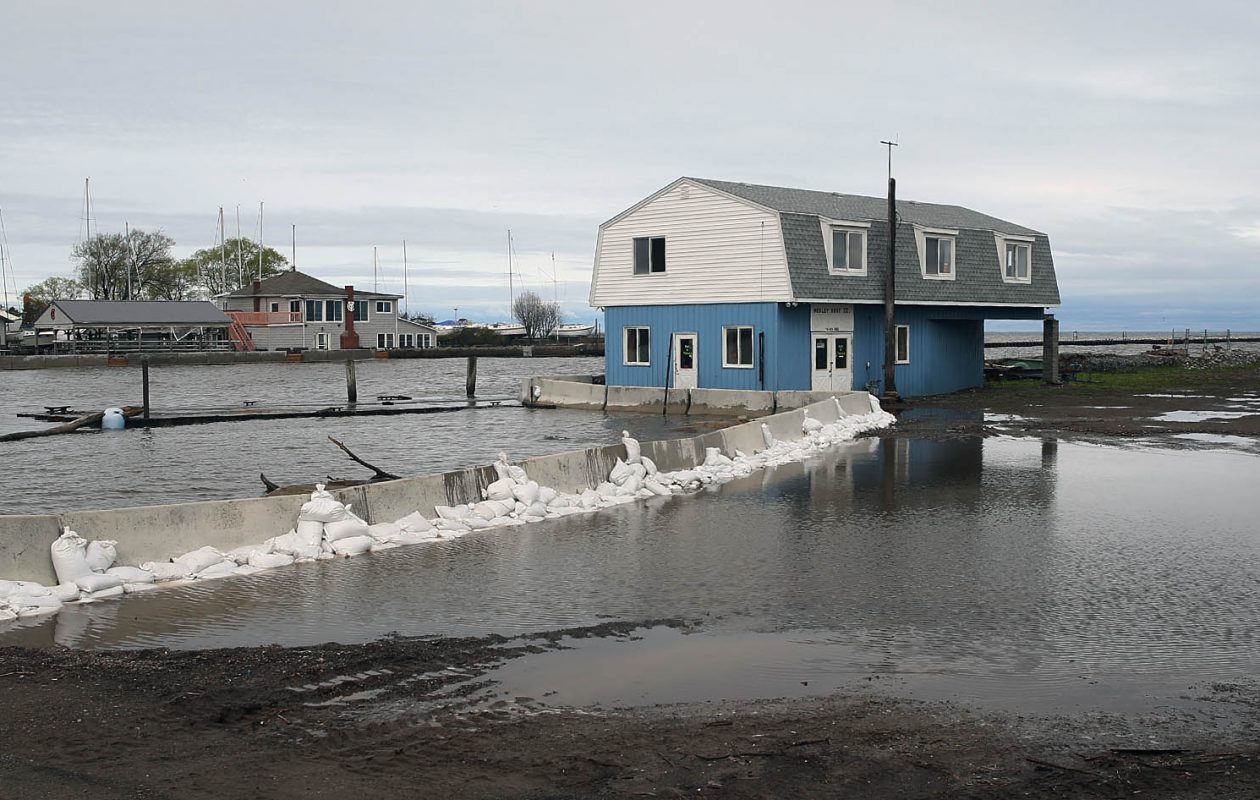 Waters from Lake Ontario surround Hedley Boat Co. at Olcott Beach in Olcott  last month. Politicians should tone down the rhetoric, look at the facts and search for solutions.  (John Hickey/Buffalo News)