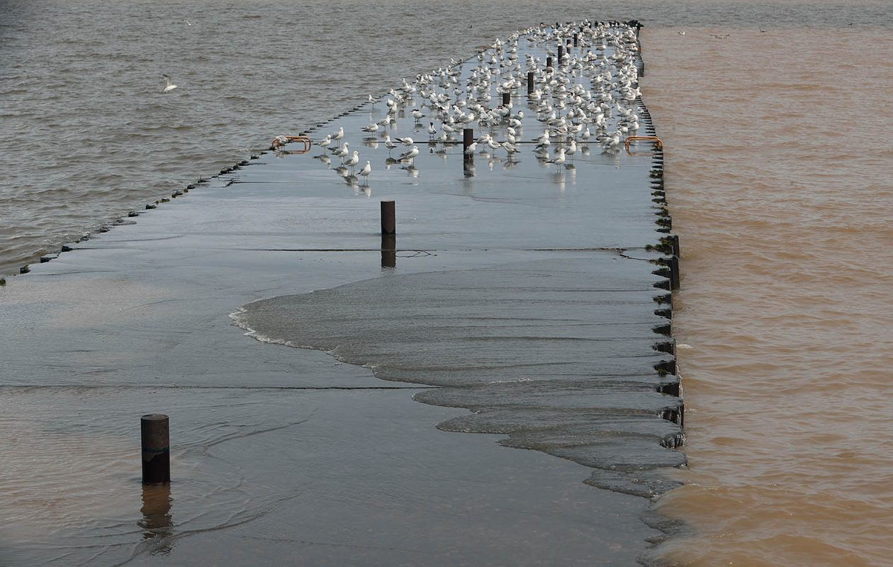 Water washes over the East Pier in May 2019. Scientists are predicting more wet winters and more high water at least for a few more years due to climate change. (John Hickey/Buffalo News)