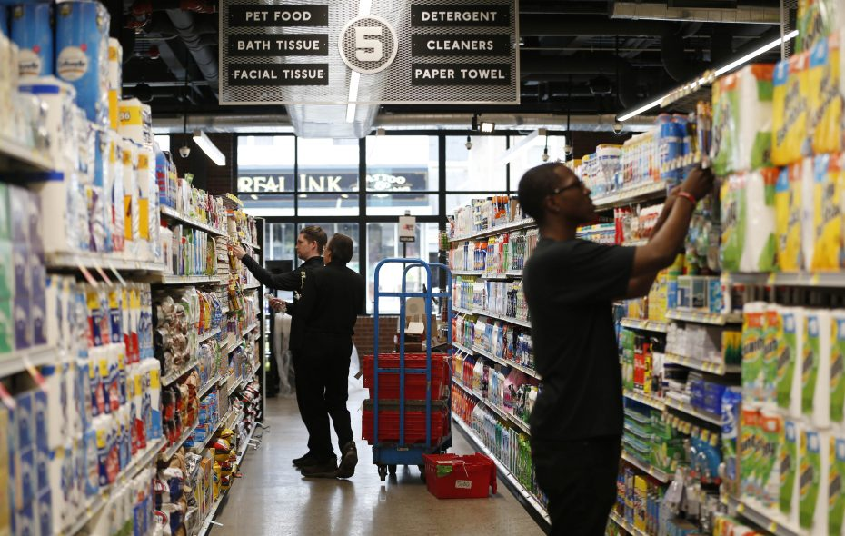 The much anticipated Dash's Market on Hertel Avenue in Buffalo is in high gear, with employees stocking shelves and preparing for its opening on Wednesday. (Sharon Cantillon/Buffalo News)