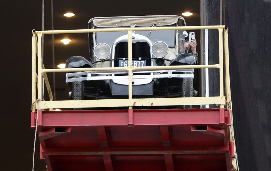 Douglas Jemal rides a 1928 Model A as it's lifted to the second floor of the One Seneca Tower in Buffalo on Tuesday. (Mark Mulville/Buffalo News)