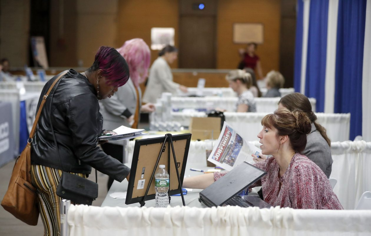 Denise Cowell, right, of Media Sales Plus, talks with Monica Lynch, left, during the Buffalo News Job Fair on Thursday. (Mark Mulville/Buffalo News)
