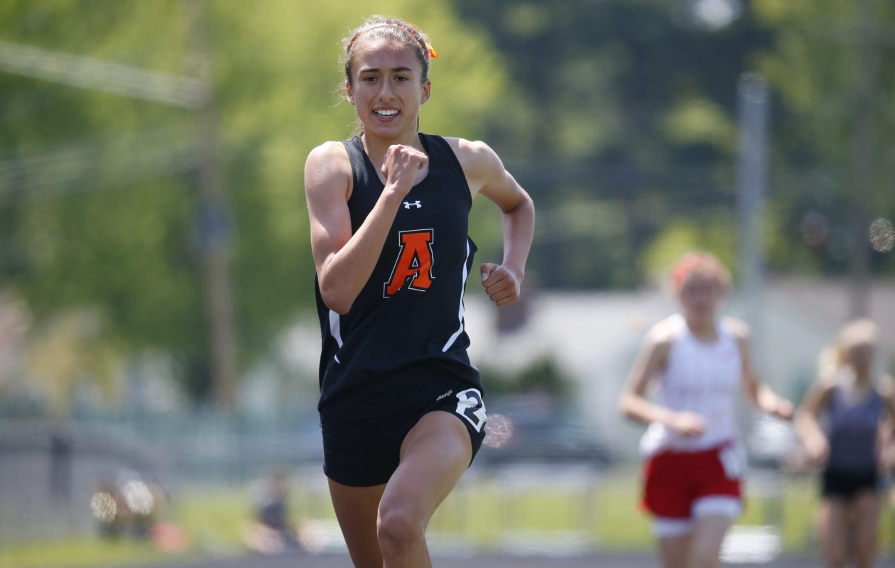 Amherst's Mallory Grubb wins the 1500 at the ECIC meet Saturday at Hamburg High School. (Harry Scull Jr./Buffalo News)