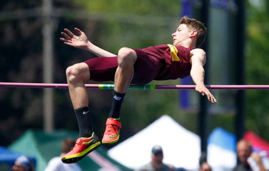 Jake Kaminski from Cheektowaga clears 6-7 at the ECIC track and field championships at Hamburg High School on Saturday. (Harry Scull Jr./Buffalo News)