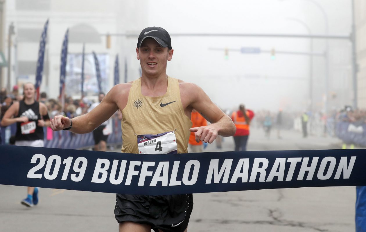 Men's winner Joe Whalen crosses the finish line during the Buffalo Marathon Sunday, May 26, 2019.  (Mark Mulville/Buffalo News)