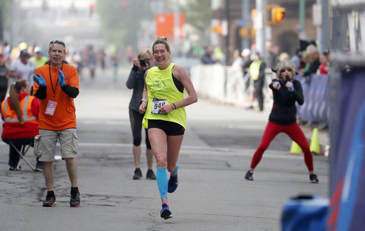 Aileen Hoak-Lange of Colden crosses the finish line during the Buffalo Marathon Sunday, May 26, 2019. (Mark Mulville/Buffalo News)