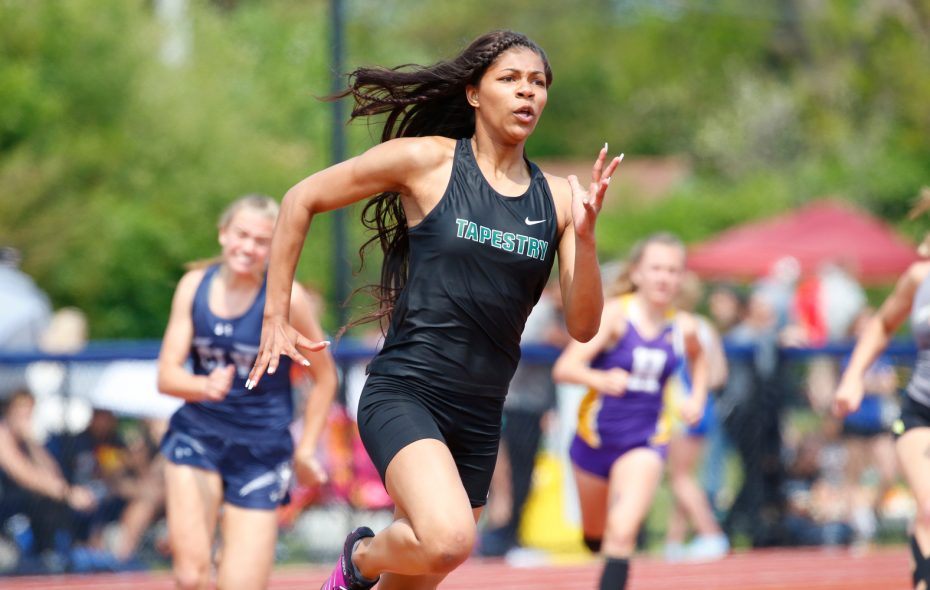 Nia Stevens from Tapestry anchored the 4x100 relay team's record-setting effort during the first day of the Section VI Track and Field Championship State Meet Qualifier at Williamsville South. (Harry Scull Jr./Buffalo News)