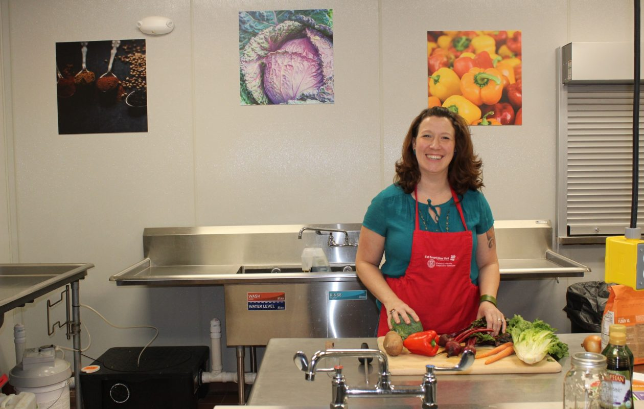 Cornell Cooperative Extension of Niagara County Nutritionist Mollie McDonough shows off the new commercial kitchen in Lockport. The extension will host an open house there on Thursday. (Photo courtesy of CCE of Niagara County)