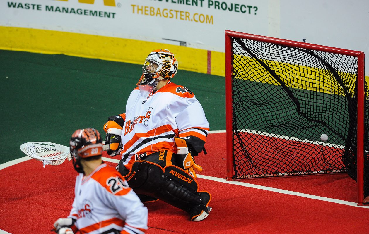 Bandits goaltender Matt Vinc can't stop a shot from Calgary's Rhys Duch  in overtime, giving the Roughnecks a 14-13 victory and the NLL Champion's Cup with a two-game series sweep.  (Photo by Derek Leung/Buffalo News)