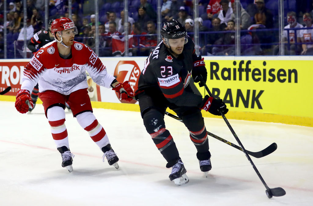 Canada's Sam Reinhart, a winger for the Buffalo Sabres, challenges Phillip Bruggisser of Denmark during a 5-0 win at the IIHF World Championship on Monday in Kosice, Slovakia. (Getty Images)