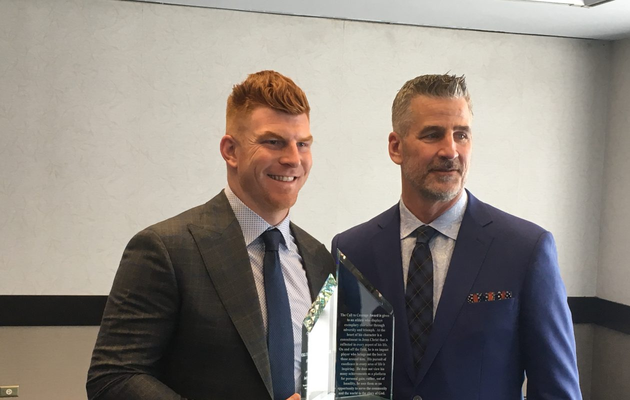 Andy Dalton receives the Call to Courage Award from Frank Reich. (Buffalo News)