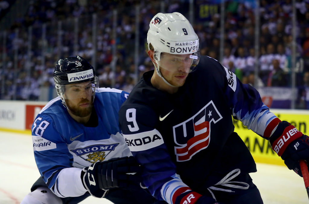 Jack Eichel challenges Finland's Jani Hakanpaa during Team USA's overtime win over Finland Monday in Kosice, Slovakia. (Getty Images)