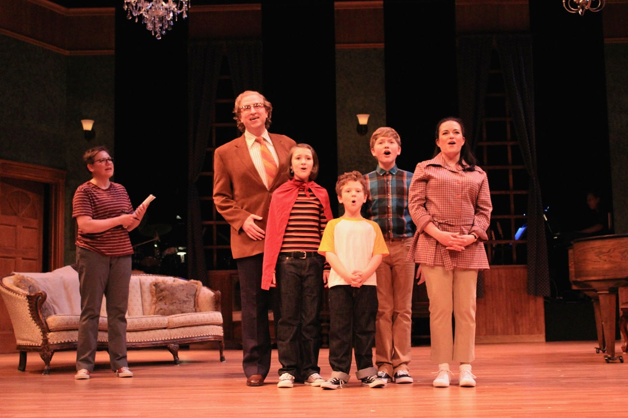 Emotions spill into song in MusicalFare Theatre's production of 'Fun Home.' Pictured as the  Bechdel family are, from left, Robyn Lee Horn (Alison), Chris J. Handley (Bruce/Dad), Jane Hereth (Small Alison), Jasper Brown (John), Joseph Bielecki (Christian), and Michele Marie Roberts (Helen). (Photo by Jesse Sloier)