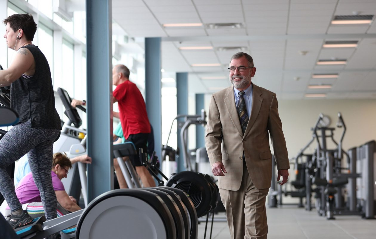 "Olin 'Buddy' Campbell, who retired this month as president and CEO of YMCA Buffalo Niagara, has learned a lot about how to run a successful Y branch, after 50 years with the organization. ""I'm a fanatic about cleanliness,"" he says. ""Branches have to be clean. That's the most basic thing people are looking for. Equipment has to be kept up and current. Then there's customer service, the engagement of people. Staff needs to smile and make them feel welcome."" (Sharon Cantillon/Buffalo News)"