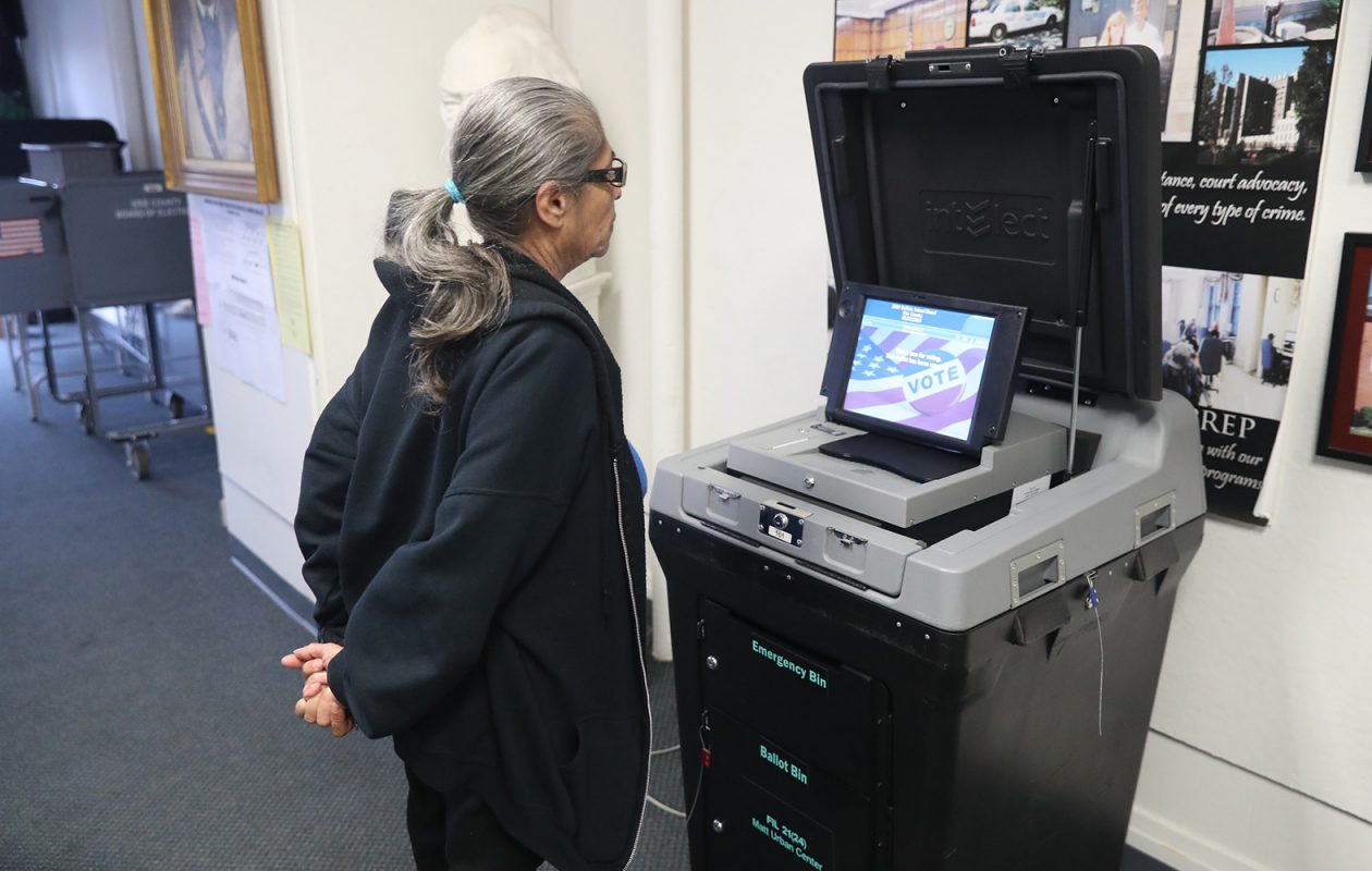 Joanne Wade votes in Tuesday's Buffalo School Board election. The paltry turnout of 6.6 percent makes the case for a fundamental change in the district's structure. (John Hickey/Buffalo News)