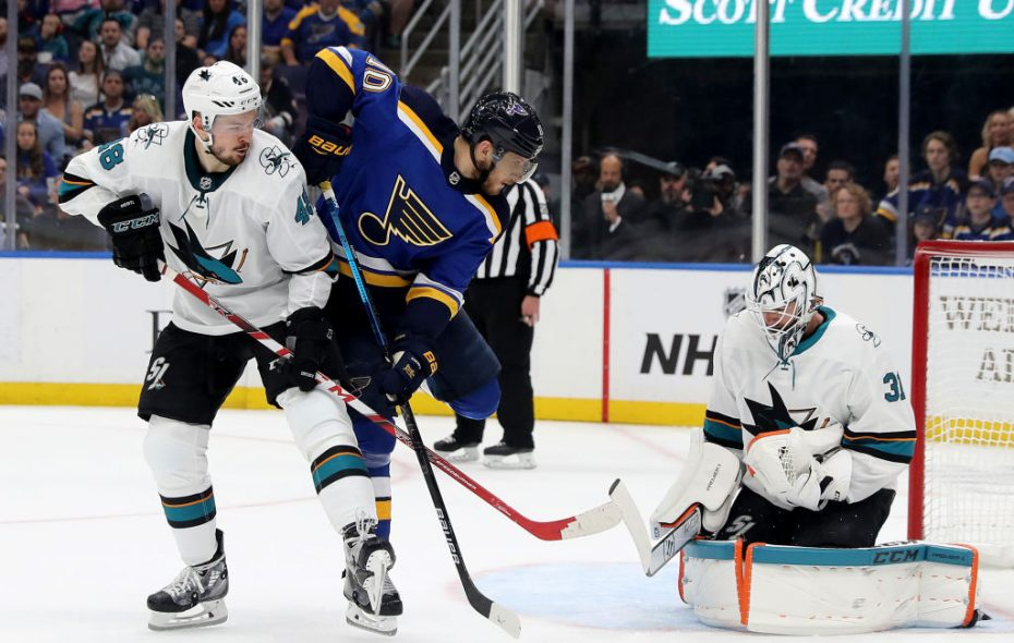 Sharks goalie Martin Jones gets help from Tomas Hertl in making a save on St. Louis' Brayden Schenn during Game 3 of the Western Conference final. (Getty Images)