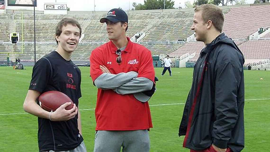 A teenage David Sills, left, chats with Southern Cal quarterbacks Matt Cassel and Matt Barkley. Photo courtesy of Arash Markazi.