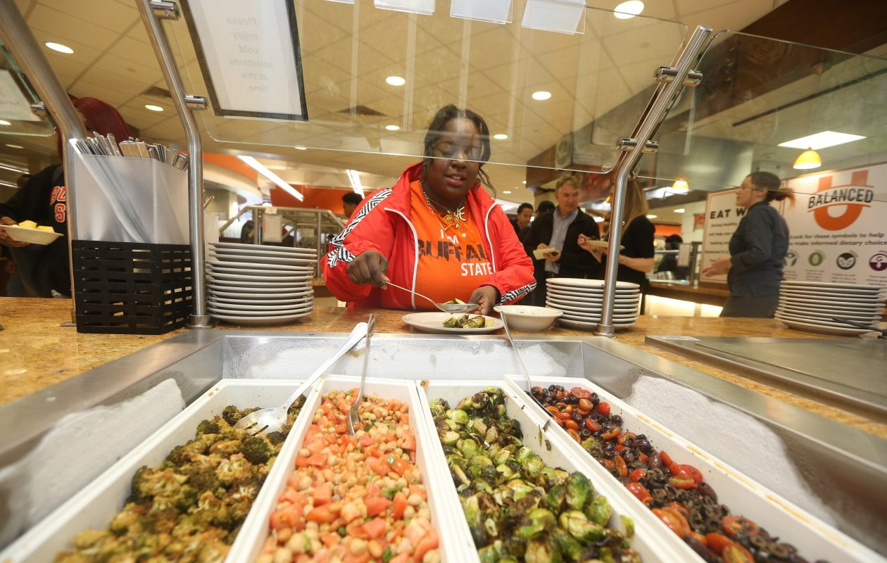 Tanisha Simmons chooses some Orange Dot healthy foods in the SUNY Buffalo State Bengal Kitchen, a dining center in the Campbell Student Union. Simmons, a fashion major, changed her diet as part of a new nutrition counseling program at the school.  (John Hickey/Buffalo News)