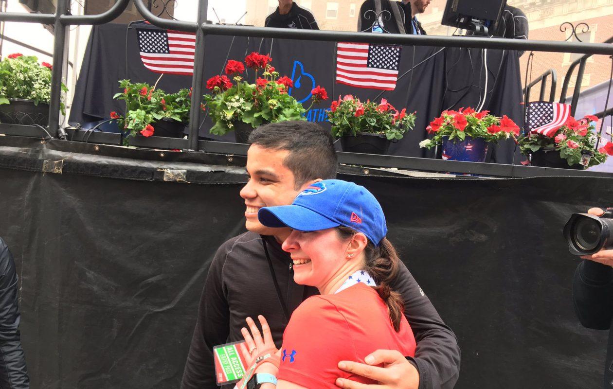 Andrew Torres, left, and Kristin Waldby, got engaged at the finish line of the Buffalo Marathon on Sunday. (Buffalo News)