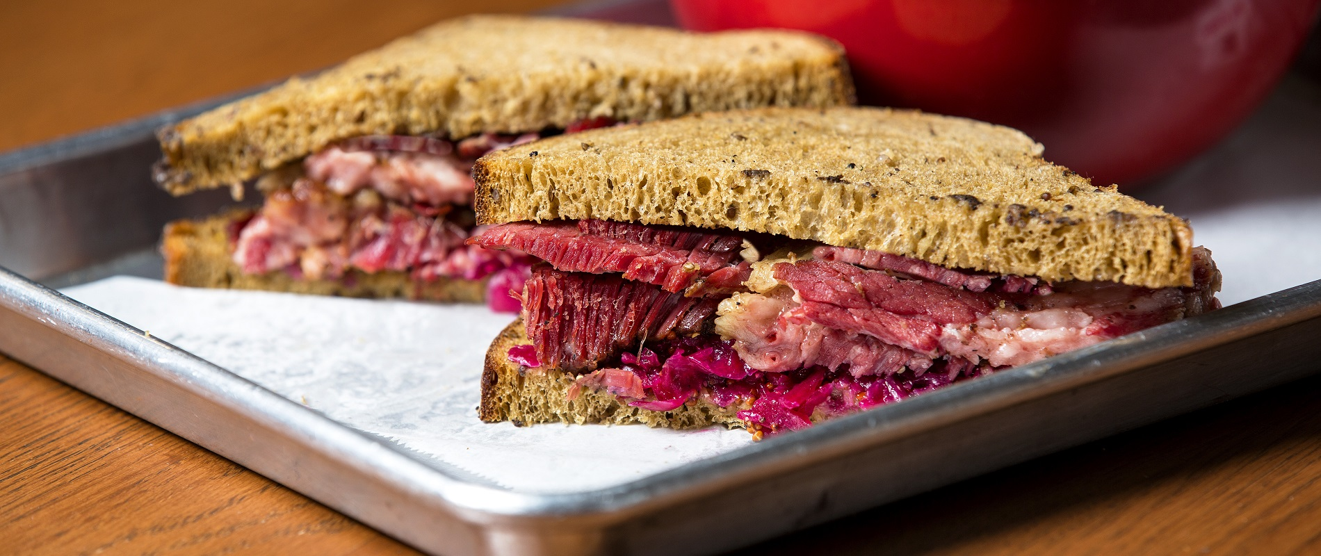 "News Food Editor Andrew Galarneau wants you to travel to Cleveland, and go to Larder Delicatessen and Bakery to ""bite into the pastrami sandwich, lush, tender and smoky on house-baked rye bread, leavened with the crunchy zing of red sauerkraut and housemade mustard. (Karin McKenna/Special to The News)"