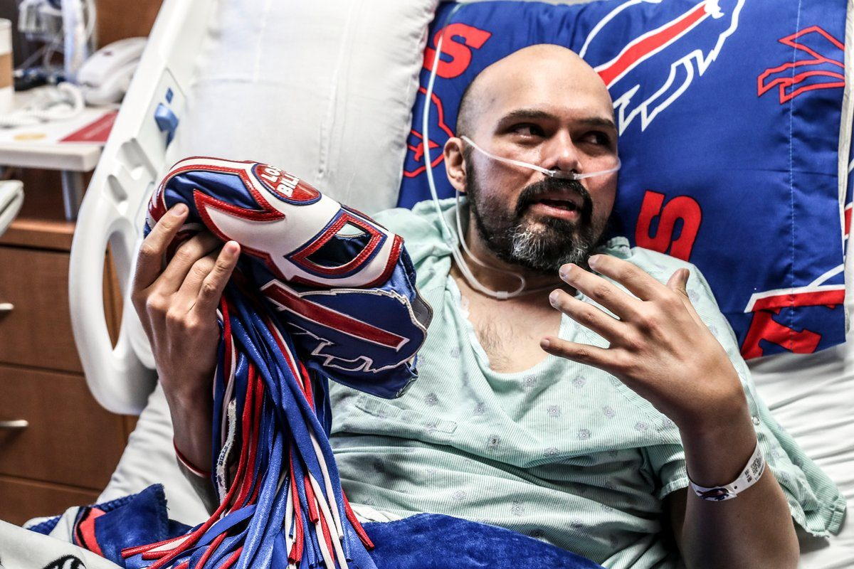 From a hospital bed last month at the MD Anderson Cancer Center in Houston, Ezra Castro holds his Pancho Billa mask and explains its meaning in his life. Castro, 39, died Tuesday in Dallas. (James P. McCoy/Buffalo News)