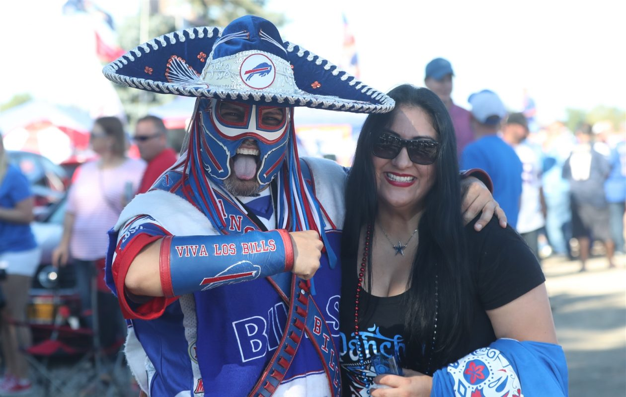 The late Ezra Castro, often called Pancho Billa, at a Buffalo Bills game with Veronica Borjon, his longtime partner. (James P. McCoy/News file photo)