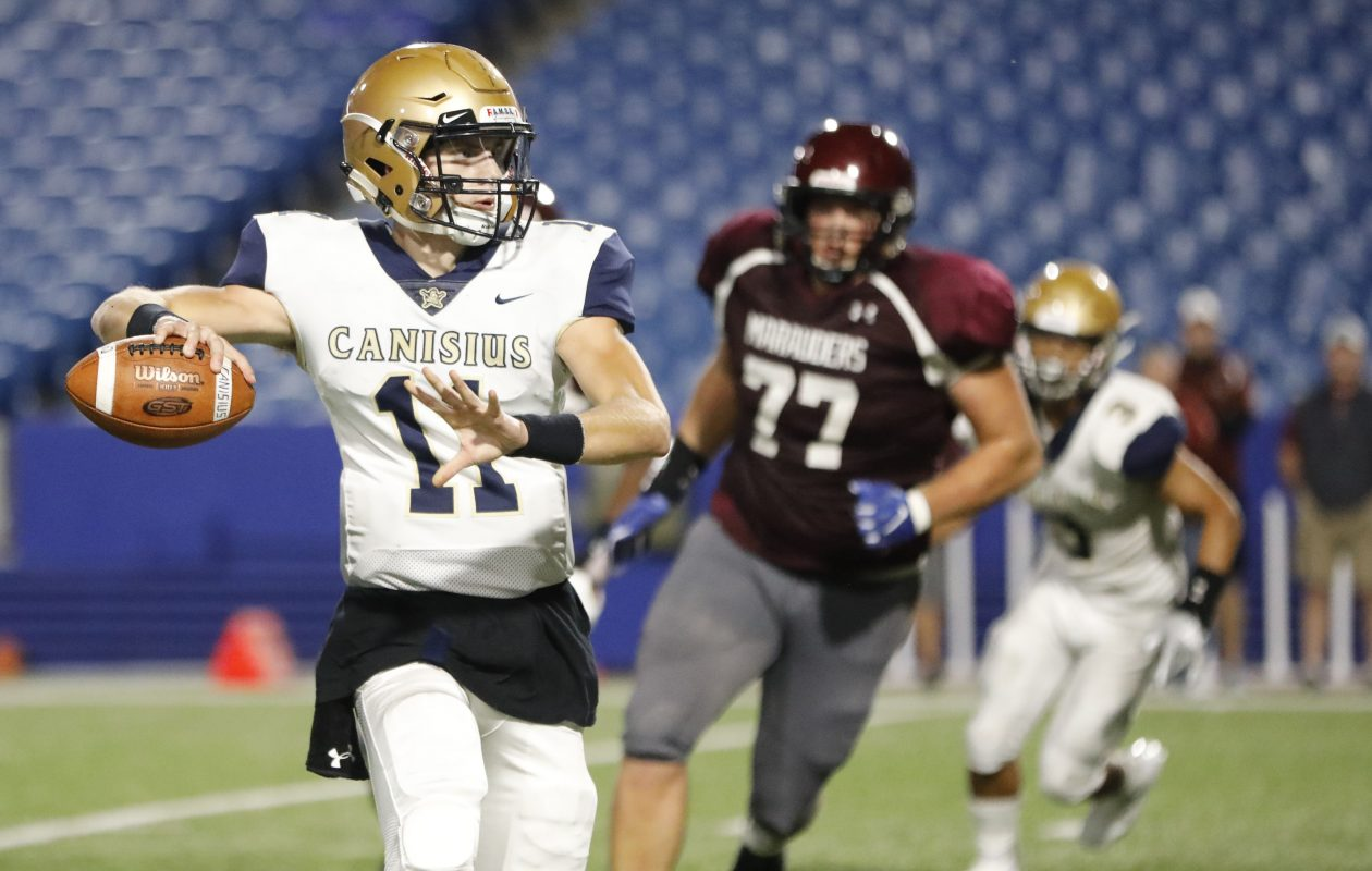 Canisius quarterback Christian Veilleux throws on the run during the Crusaders' win over St. Joe's last season at New Era Field. (Derek Gee/Buffalo News)