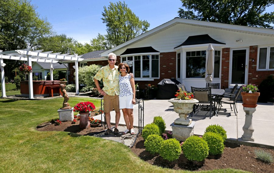 Mike and Rose Tucker on the patio of their waterfront home on Grand Island. (Robert Kirkham/Buffalo News)