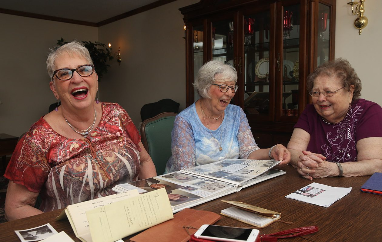 Audrey Owen, right,  found out through DNA testing that she was born as part of a spontaneous date at Crystal Beach, which led her to a meeting with two Canadian sisters she never knew she had, all three the daughters of Fred McColman. Here Audrey meets Sharon Wingrove, left, of Pine Lake, Ont., and Linda Lee Costen, of Brantford,Ont. (John Hickey/Buffalo News)