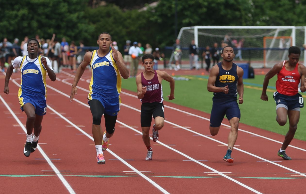 Lockport's Malik Brooks wins the Division I 100-meter dash at the Section VI state qualifier at Williamsville South High School Saturday. (John Hickey/Buffalo News)