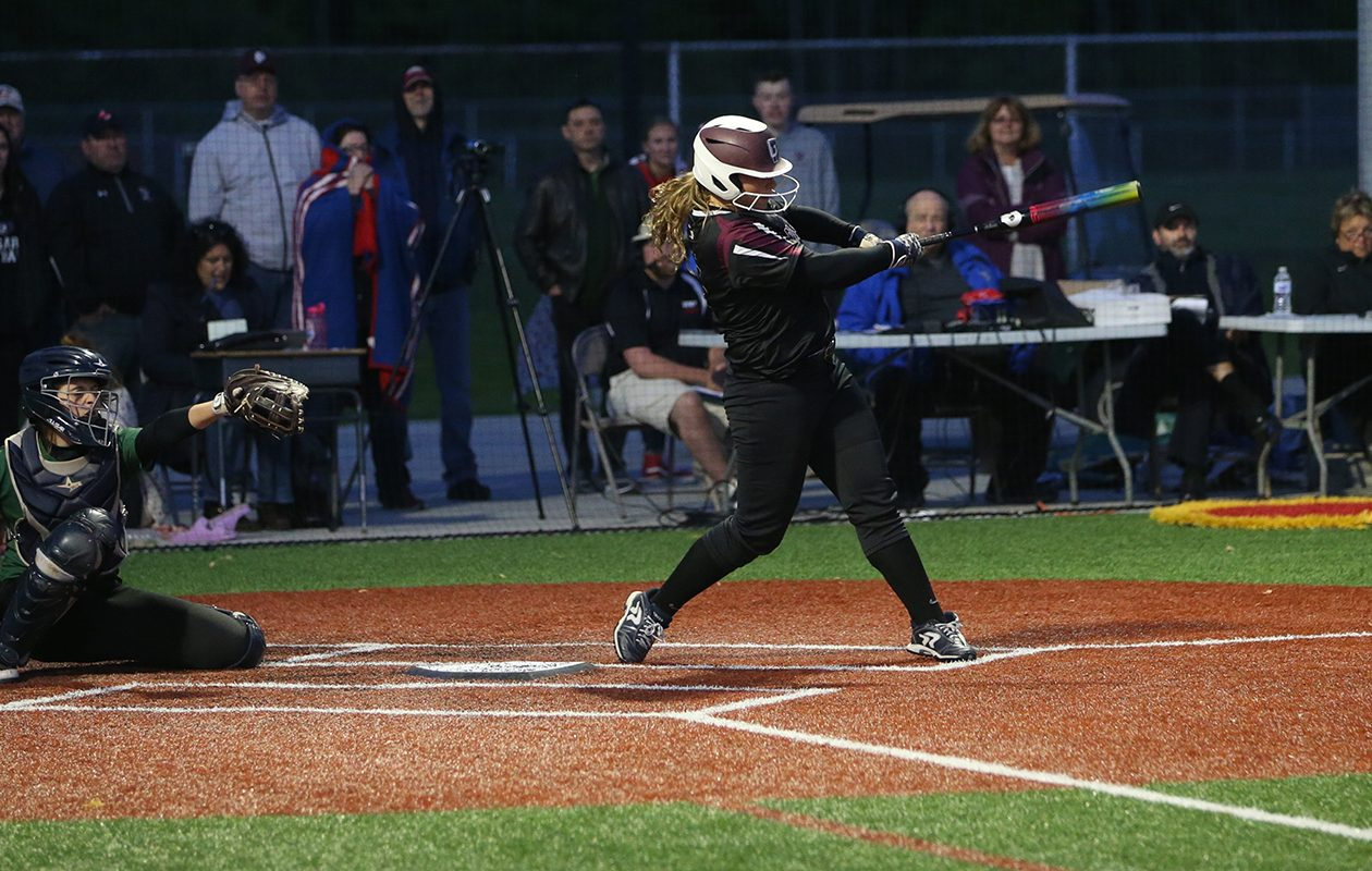 Orchard Park's Megan Giese follows through on a hit to win the game in the bottom of the 9th inning against Williamsville North in the Section VI Class AA softball final on Monday, June 3, 2019, at Williamsville East High School. (John Hickey/Buffalo News)