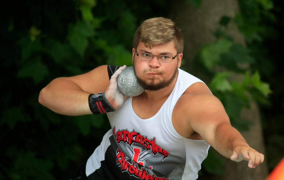Jon Surdej from Lancaster competes in the Division I shot put, winning his fourth straight state championship. (Harry Scull Jr./Buffalo News)