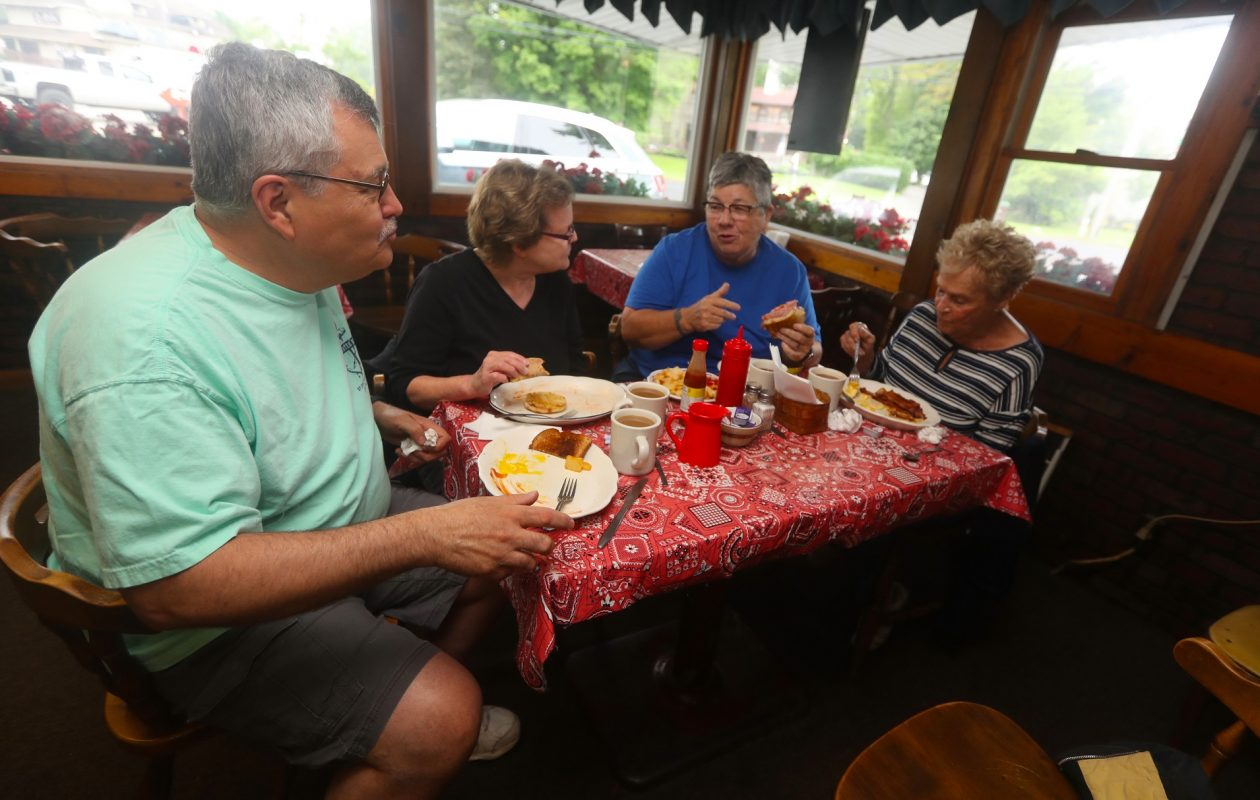 Paul Kracht, left, his wife Barb, Margie Moses and Audrey Smith, all of Orchard Park, enjoy breakfast at Joan & Sue's Family Restaurant. (John Hickey/Buffalo News)