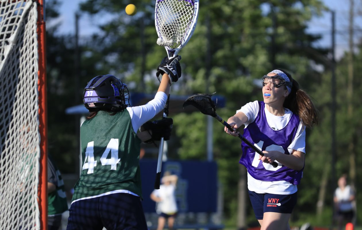 Beth Wolcott from Grand Island scores during the All-WNY Girls Lacrosse game at Sweet Home High School Tuesday. (Harry Scull Jr./Buffalo News)