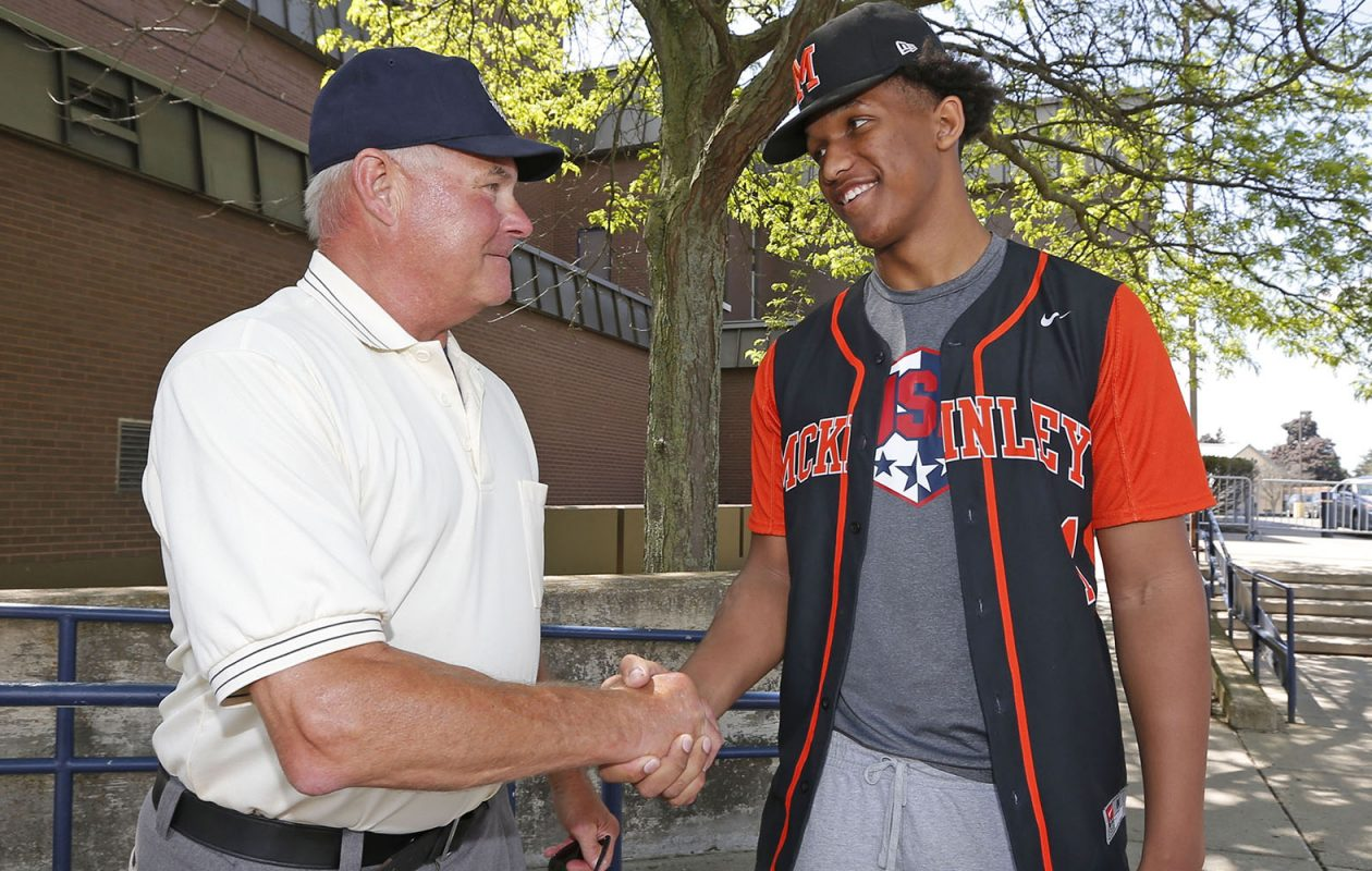 Alexander 'Gator' Johnson, right, and Doug Zavodny, a longtime umpire, speak at Demske Field about how they were both selected in the baseball draft out of McKinley High School.  (Robert Kirkham/Buffalo News)