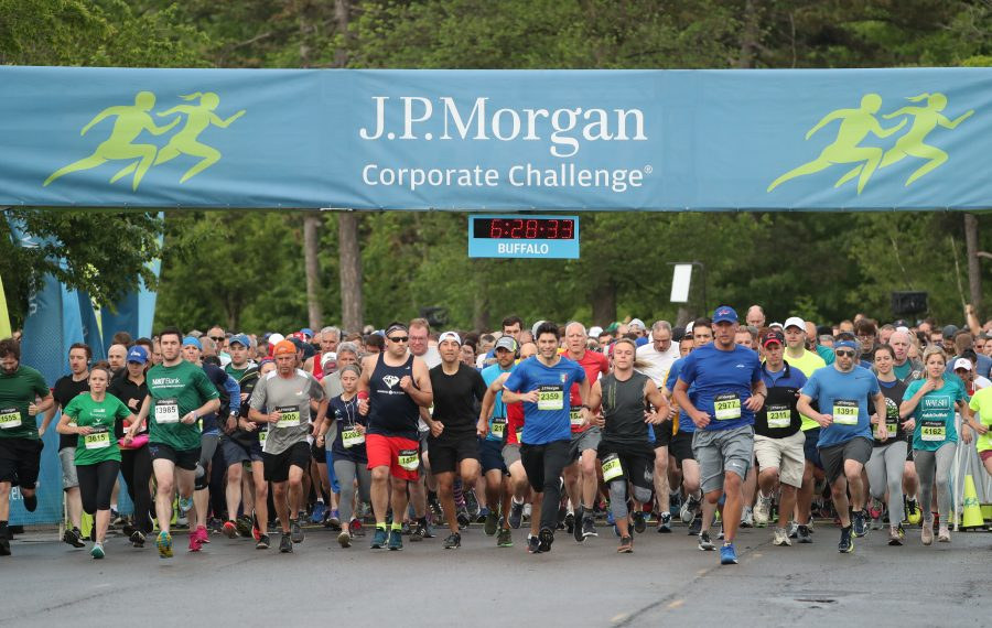 This is the start of the second heat. More than 13,000 runners from nearly 500 area companies participated in the JP Morgan Corporate Challenge at Delaware Park Thursday. (James P. McCoy/Buffalo News)