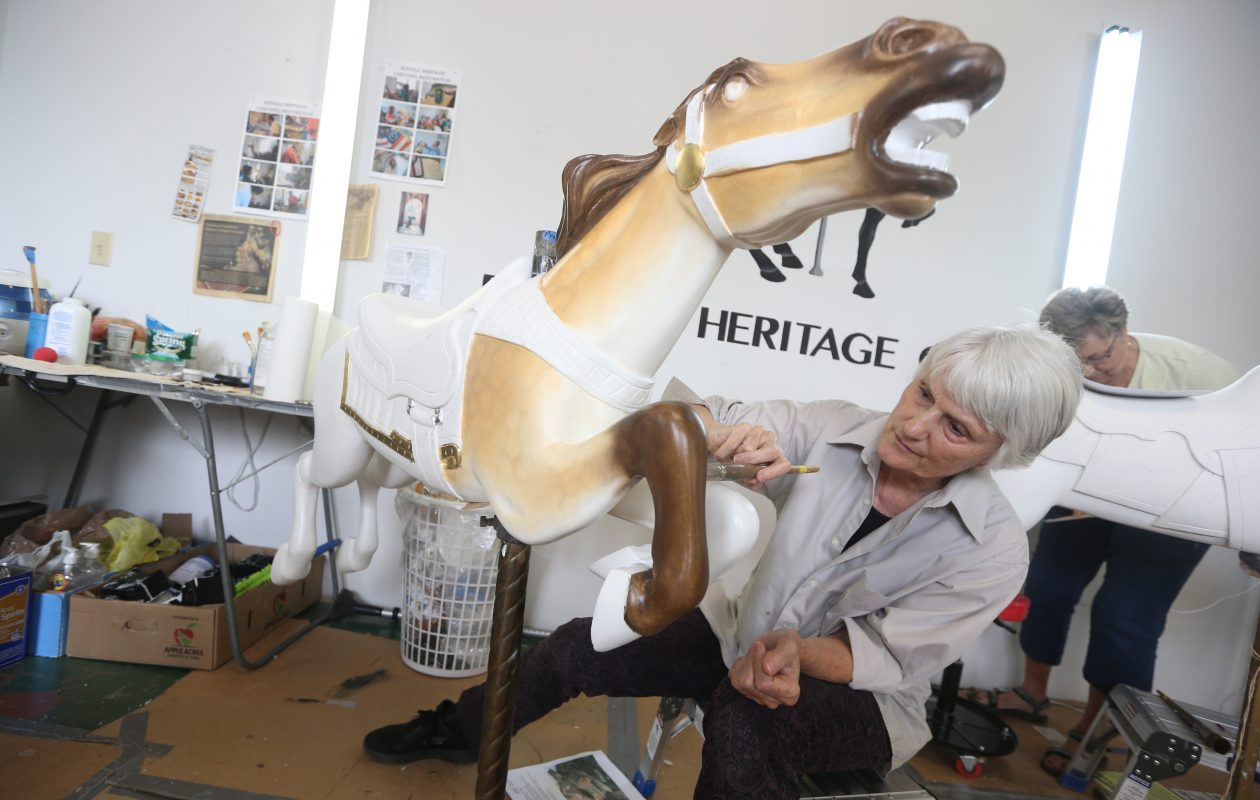 Rosa Patton, a renowned carousel painter based in North Carolina, returns to North Tonawanda periodically to check on and supervise the volunteers who are restoring a vintage carousel. (John Hickey/Buffalo News)