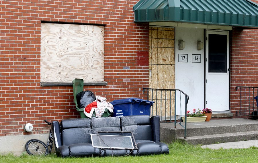 Residents say furniture removed from a vacant Shaffer Village apartment has remained outside  the unit. (Robert Kirkham/Buffalo News)