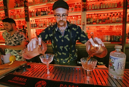 Downtown Buffalo's Angelica Tea Room on Washington Street has transformed into an exotic Tiki Bar for the summer and newbies and regulars are embracing it. They did their homework and explored new and ancient cocktails and put on quite a show preparing them for anyone who's interested.