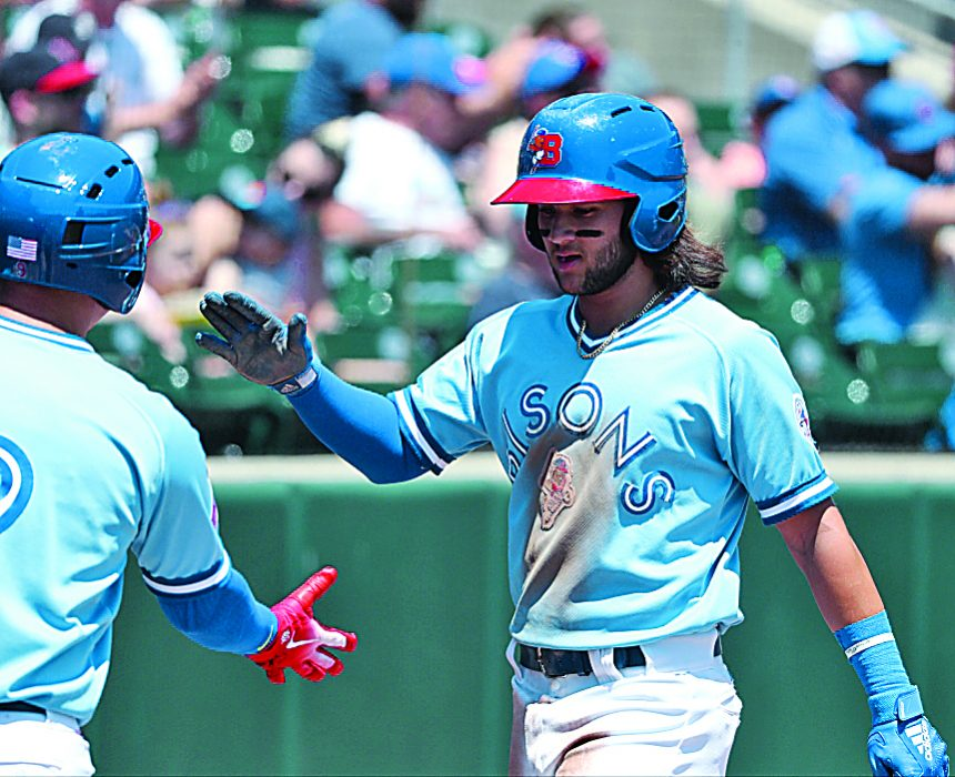 Buffalo Bisons shortstop Bo Bichette is greeted after  scoring in the first inning against Norfolk Sunday. (James P. McCoy/Buffalo News)